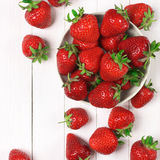 Strawberries on white wood Stock Images