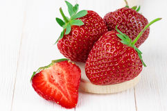 Strawberries on white wood Royalty Free Stock Photo
