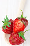 Strawberries on white wood Royalty Free Stock Photography