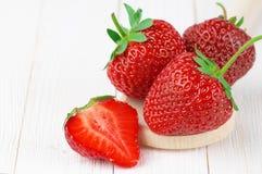 Strawberries on white wood Stock Photos