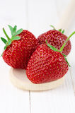 Strawberries on white wood Stock Photography