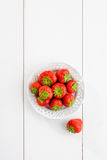 Strawberries on white wooden board Royalty Free Stock Photos