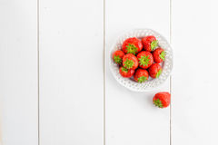 Strawberries on white wooden board, texture Royalty Free Stock Image