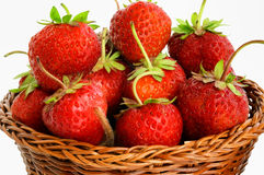 Strawberries in a wicker basket Stock Images