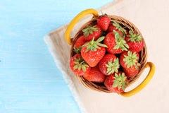 Strawberries in a wicker basket Stock Image