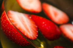 Strawberries and Wine Close-up angle. A close-up shot of strawberries floating in a glass of white wine Stock Photos