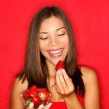 Strawberries - woman eating strawberry Stock Photo