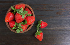Strawberries in wood bowl Royalty Free Stock Photo