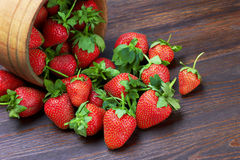 Strawberries in wood bowl Royalty Free Stock Photography
