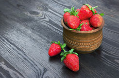 Strawberries in wood bowl Stock Image