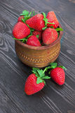 Strawberries in wood bowl Stock Photos