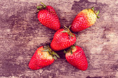 Strawberries on wood forming shape Royalty Free Stock Photography