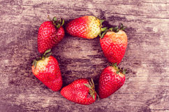 Strawberries on wood forming shape Stock Images