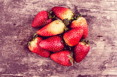 Strawberries on wood forming shape Royalty Free Stock Photo