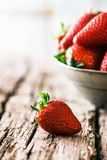 Strawberries on wood stock photography