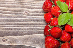 Strawberries on a wooden background Stock Photography
