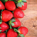 Strawberries on Wooden Background Royalty Free Stock Images