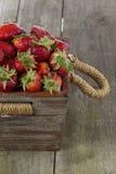 Strawberries wooden basket royalty free stock photos