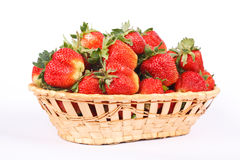 Strawberries in wooden basket isolated on white Stock Image