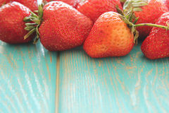 Strawberries on wooden blue desk. stock photography
