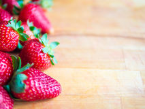 Strawberries on a wooden board with empty space. Arranged strawberries on a wooden board with empty space Stock Photography