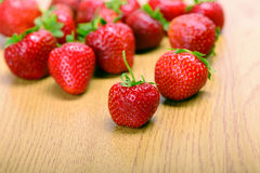 Strawberries on wooden board Royalty Free Stock Photos