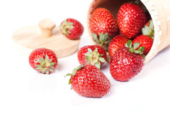 Strawberries in a wooden bowl. Juicy strawberries on a white background Stock Photo