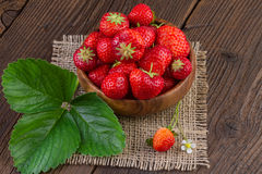 Strawberries in Wooden bowl on Jute Fabric Stock Photos