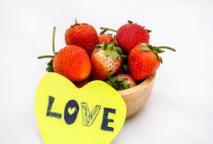 Strawberries in wooden bowl with love note. Royalty Free Stock Photo