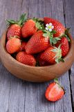 Strawberries in a wooden bowl. Strawberries in a single wooden bowl on wooden table Stock Images