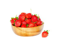 Strawberries in a wooden bowl on a white background.  Royalty Free Stock Images
