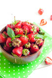Strawberries in wooden bowl. At white wooden table royalty free stock photos