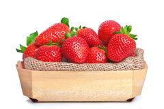 Strawberries wooden crate. On white background royalty free stock photos
