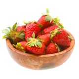 Strawberries on wooden platter on white Royalty Free Stock Photo