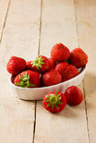 Strawberries on wooden table Royalty Free Stock Photo