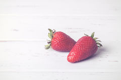 Strawberries. On a wooden table Royalty Free Stock Photos