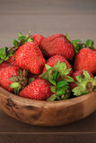 Strawberries on the wooden table Stock Images