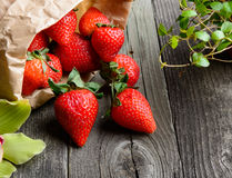Strawberries on wooden table Royalty Free Stock Photos