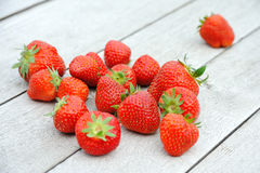Strawberries on wooden table. Fresh strawberries on oakwooden table Royalty Free Stock Photography