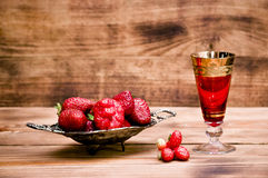 Strawberries on a wooden table Royalty Free Stock Photography