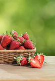 Strawberries on a wooden table Royalty Free Stock Images