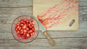 Strawberries on a wooden table. stop motion animation stock footage