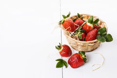 Strawberries in a woven basket Royalty Free Stock Image