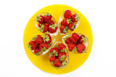 Strawberries on the yellow plate Royalty Free Stock Image
