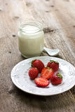 Strawberries and yogurt Royalty Free Stock Photos