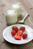 Strawberries and yogurt Stock Images