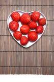 Strawberriy. Tasty strawberry on wooden background Stock Images