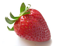 Strawberry. A sigle red strawberry isolated Stock Photos