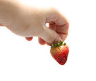 Strawberry. A Man's hand with strawberry isolated on white background stock images