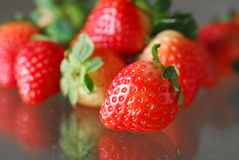 Strawberry. Many strawberry on a glass table Royalty Free Stock Photography